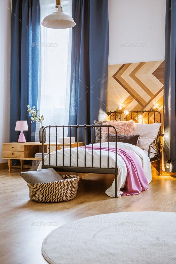 Metal bed in modern bedroom - Stock Photo - Images