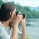 Young Woman Tourist Looking at Camera and Taking Pictures of Beautiful Landscape - VideoHive Item for Sale