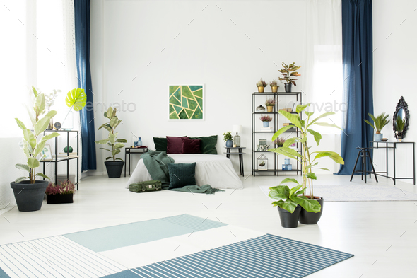 Bed in white spacious interior - Stock Photo - Images