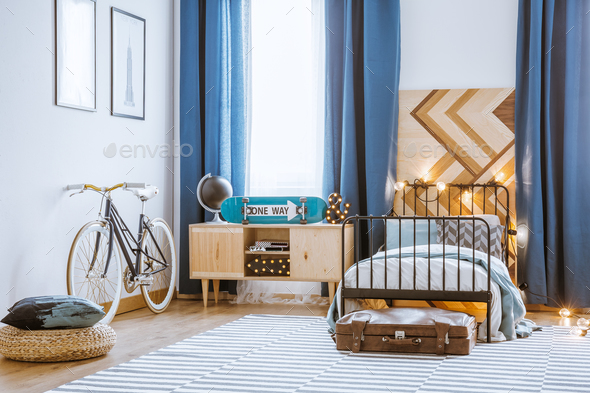 Wooden cupboard next to bed - Stock Photo - Images
