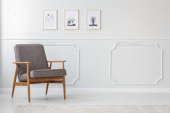 Grey wooden armchair in interior - Stock Photo - Images