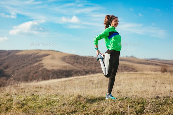 Runner Girl Stretching - Stock Photo - Images