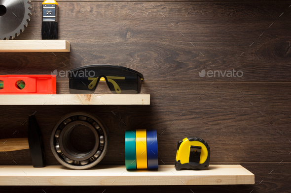 construction tools at wooden shelf - Stock Photo - Images