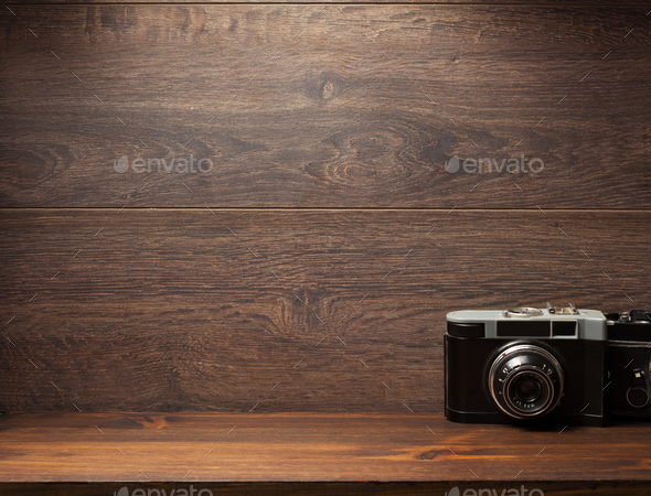 old camera at shelf wall wood - Stock Photo - Images