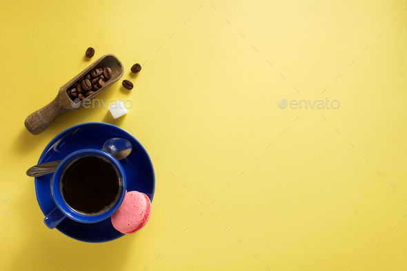 coffee cup and beans at yellow  background - Stock Photo - Images