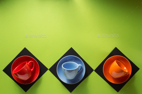 empty cup and saucer at colorful paper - Stock Photo - Images