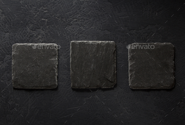 slate signboard at black background - Stock Photo - Images
