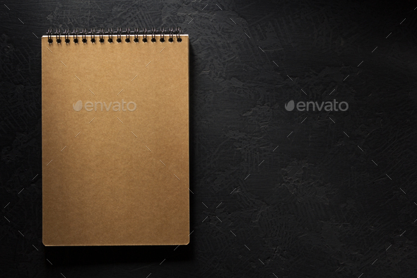 notebook on black background - Stock Photo - Images