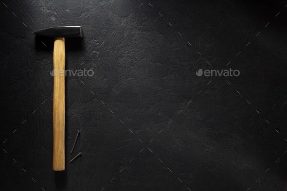 hammer tool and nail at black - Stock Photo - Images