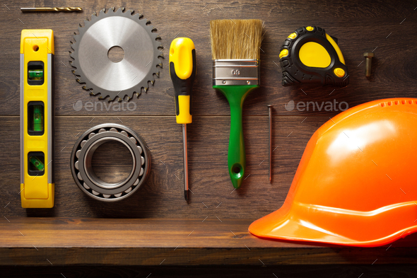 tools and shelf at brown background - Stock Photo - Images