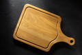 cutting board at black table - PhotoDune Item for Sale