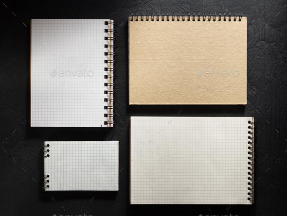 notebook on black background - Stock Photo - Images