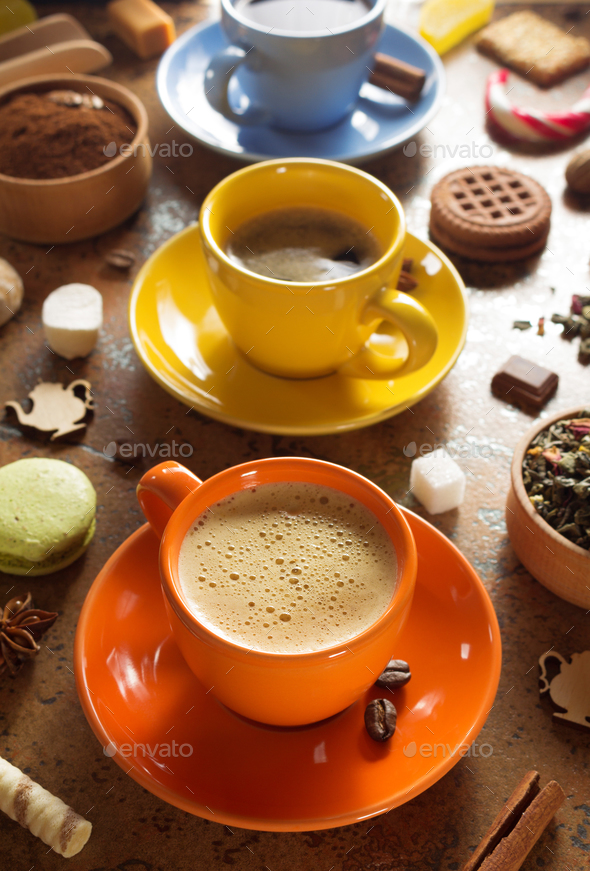 cup of coffee, tea and cacao at table - Stock Photo - Images