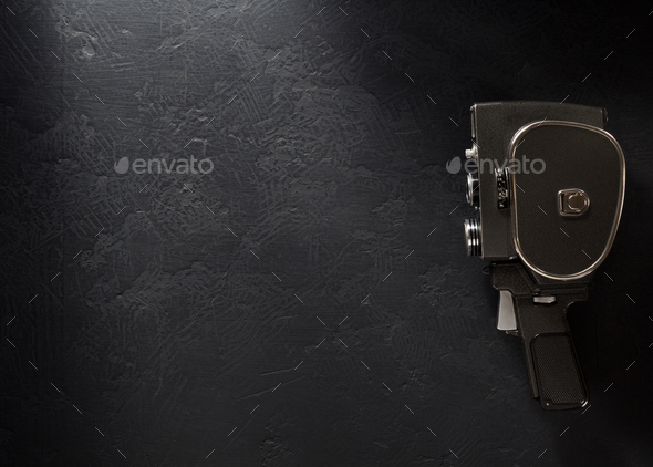 movie camera at black background - Stock Photo - Images