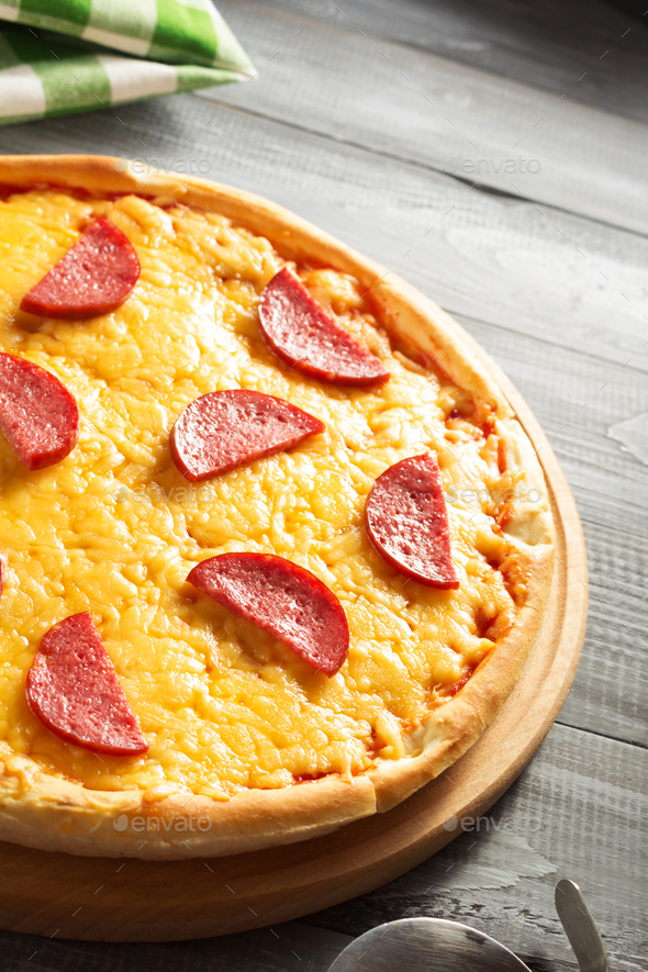 pepperoni pizza at wood - Stock Photo - Images