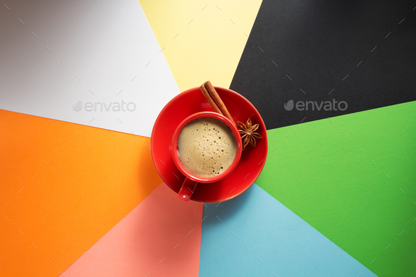 cup of coffee at colorful paper - Stock Photo - Images