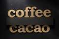 coffee and cacao letters on black - PhotoDune Item for Sale