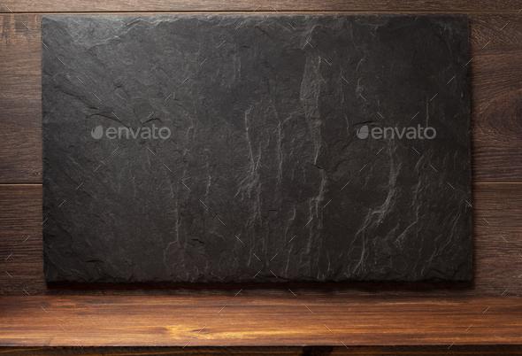black slate stone on wood - Stock Photo - Images