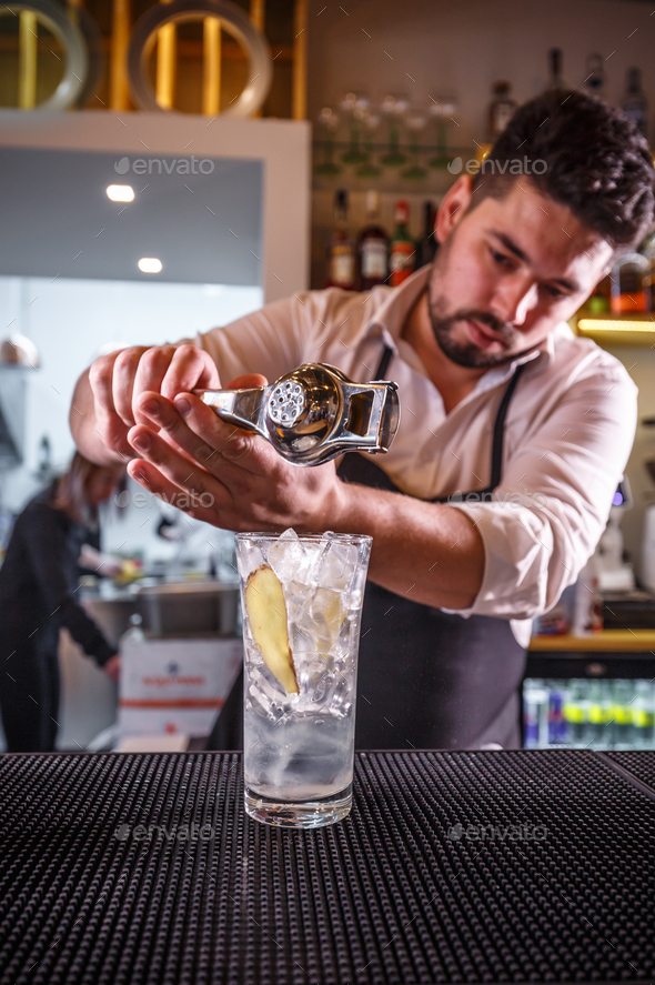 Professional bartender making cocktail - Stock Photo - Images