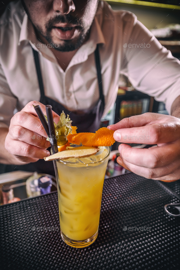 Barman is decorating cocktail - Stock Photo - Images