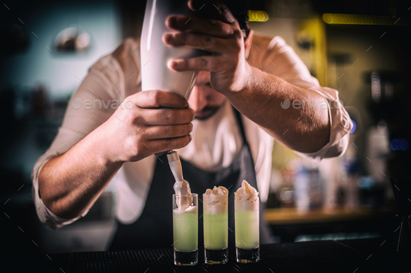 Bartender decorating shots - Stock Photo - Images
