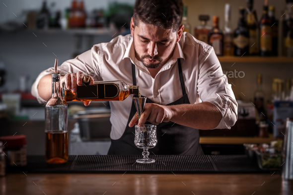 Bartender preparing alcohol cocktail drink - Stock Photo - Images