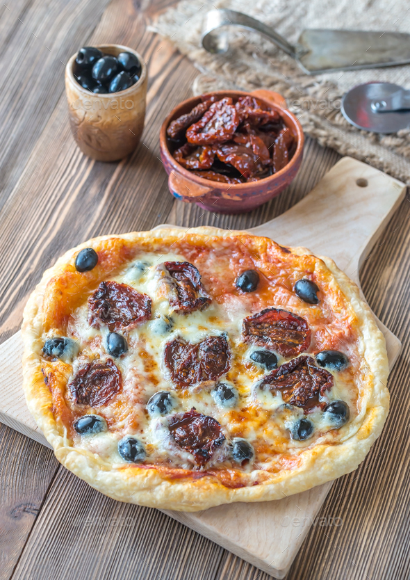 Pizza with sun-dried tomatoes  - Stock Photo - Images
