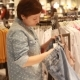 The Girl Chooses Clothes in the Store - VideoHive Item for Sale