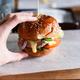 Huge burger on a wooden background close-up - PhotoDune Item for Sale