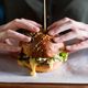 Woman's hands with hot burger. Fast food concept. Close up view - PhotoDune Item for Sale