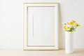 Gold decorated frame mockup with yellow and white daisy - PhotoDune Item for Sale