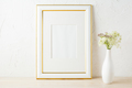 Gold decorated frame mockup with white and pink wildflowers - PhotoDune Item for Sale