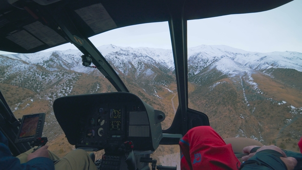 Inside View Of A Helicopter In Flight With Man And Pilots Flying