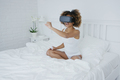Content woman in VR glasses on bed - PhotoDune Item for Sale