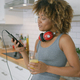 Casual woman relaxing with phone in kitchen - PhotoDune Item for Sale