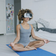 Content woman meditating in VR glasses - PhotoDune Item for Sale