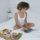 Content woman with laptop and breakfast - PhotoDune Item for Sale