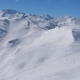 Panning Snowy Mountains At A Ski Resort, Many Skiers On The Slope - VideoHive Item for Sale