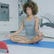 Content woman meditating at home - PhotoDune Item for Sale