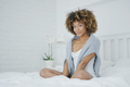 Charming model posing on bed - PhotoDune Item for Sale