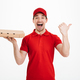 Smiling young delivery man holding pizza. - PhotoDune Item for Sale