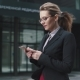 Girl in a Business Suit Sends a Texting on Mobile Phone - VideoHive Item for Sale