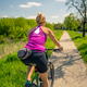 Cycling girl on mountain bike in city park, summer day - PhotoDune Item for Sale