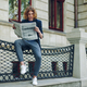 Attractive man reading newspaper near old style building - PhotoDune Item for Sale