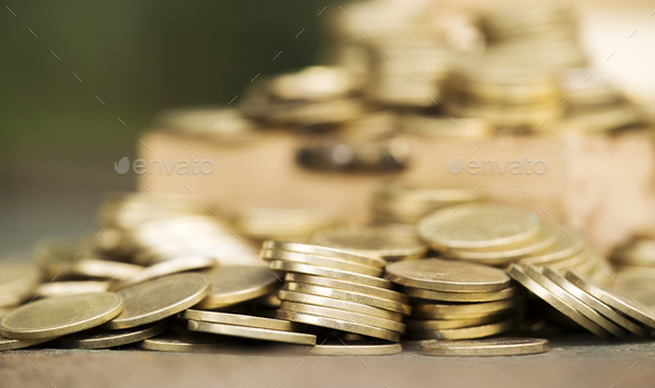 Financial planning concept - gold money coins background - Stock Photo - Images