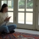 Young Woman Sitting in Lotus Position Indoor - VideoHive Item for Sale