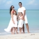 Young Family in White on Vacation on Caribbean Beach - VideoHive Item for Sale