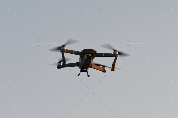 Drone quad copters with high resolution digital camera flying aerial - Stock Photo - Images