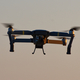 Drone quad copters with high resolution digital camera flying aerial over sunset orange sky - PhotoDune Item for Sale