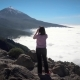 Girl Looks at the Clouds and the Volcano - VideoHive Item for Sale